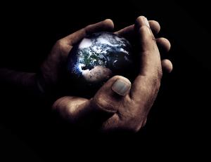 World in God's hands - earth globe