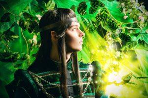 Beautiful male elf in the magic forest. Fantasy. Fairy tale, magic.